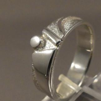 Asring zilver met as verwerkt in ascontainer